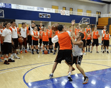 Basketball Camp Director Illustrating Play