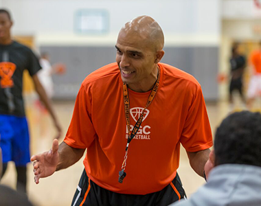 Basketball Camp Director Talking to Coaches